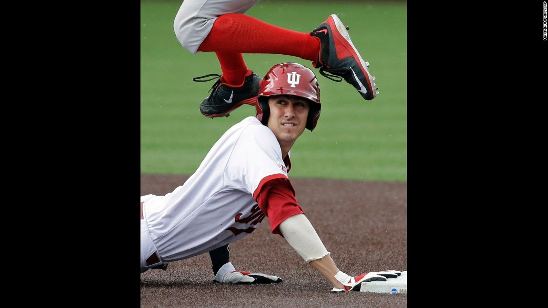 Indiana's Nick Ramos looks at the umpire as Radford infielder Danny Hrbek leaps over him during an NCAA tournament game Sunday, May 31, in Nashville, Tennessee. Ramos was the second out of a double play.
