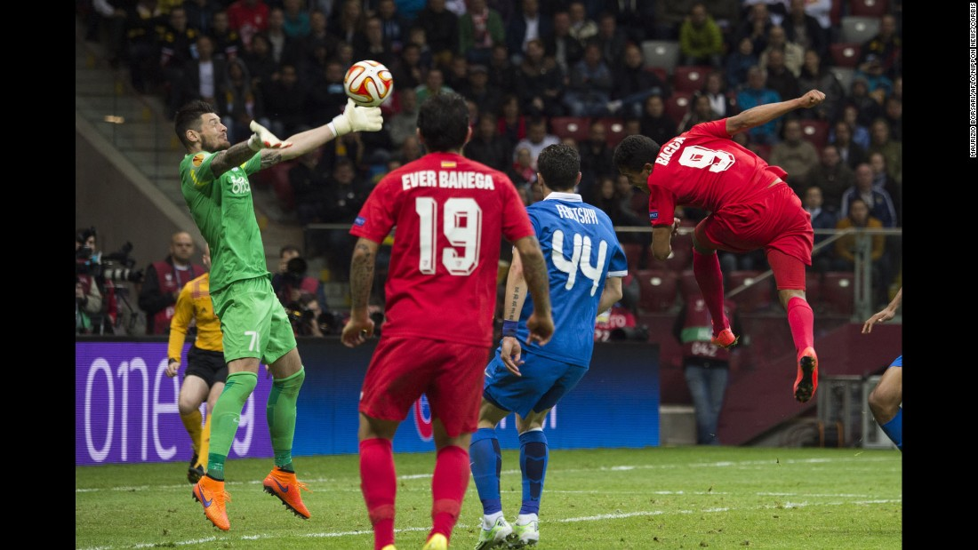 Denys Boyko, goalkeeper for Dnipro Dnipropetrovsk, reaches for a header by Sevilla's Carlos Bacca during the Europa League final Wednesday, May 27, in Warsaw, Poland. Bacca had two goals in the match as Sevilla won 3-2. It is the fourth time that the Spanish club has won the tournament, which used to be called the UEFA Cup.