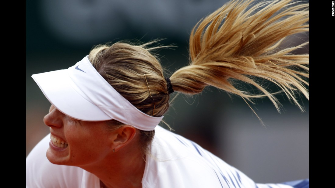 Maria Sharapova hits a shot during her third-round match at the French Open on Friday, May 29. Sharapova beat Samantha Stosur in straight sets.