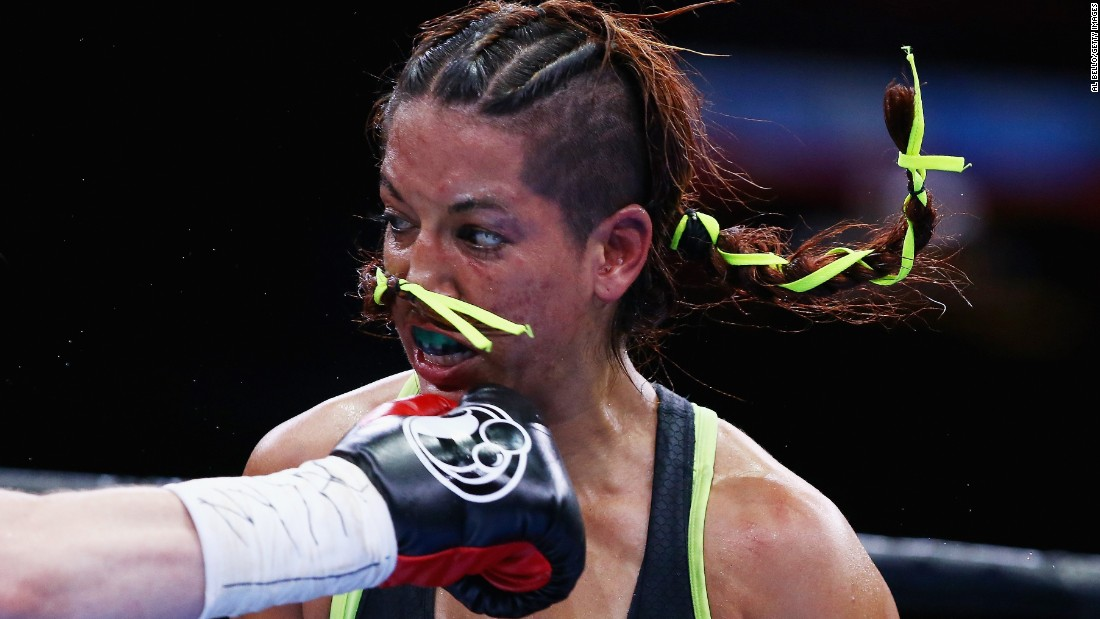 Noemi Bosques is punched by Heather Hardy during their junior featherweight bout in New York on Friday, May 29. Hardy won by split decision.