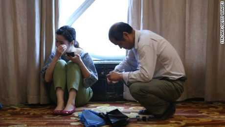 Relatives of passengers on board the ship wait for information at a hotel in Nanjing, China, June 2.
