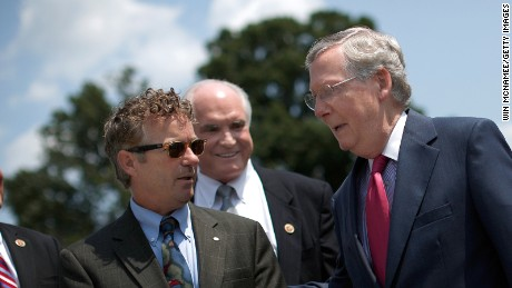 Mitch McConnell greets Sen. Rand Paul at a news conference outside the U.S. Capitol on July 30, 2014.
