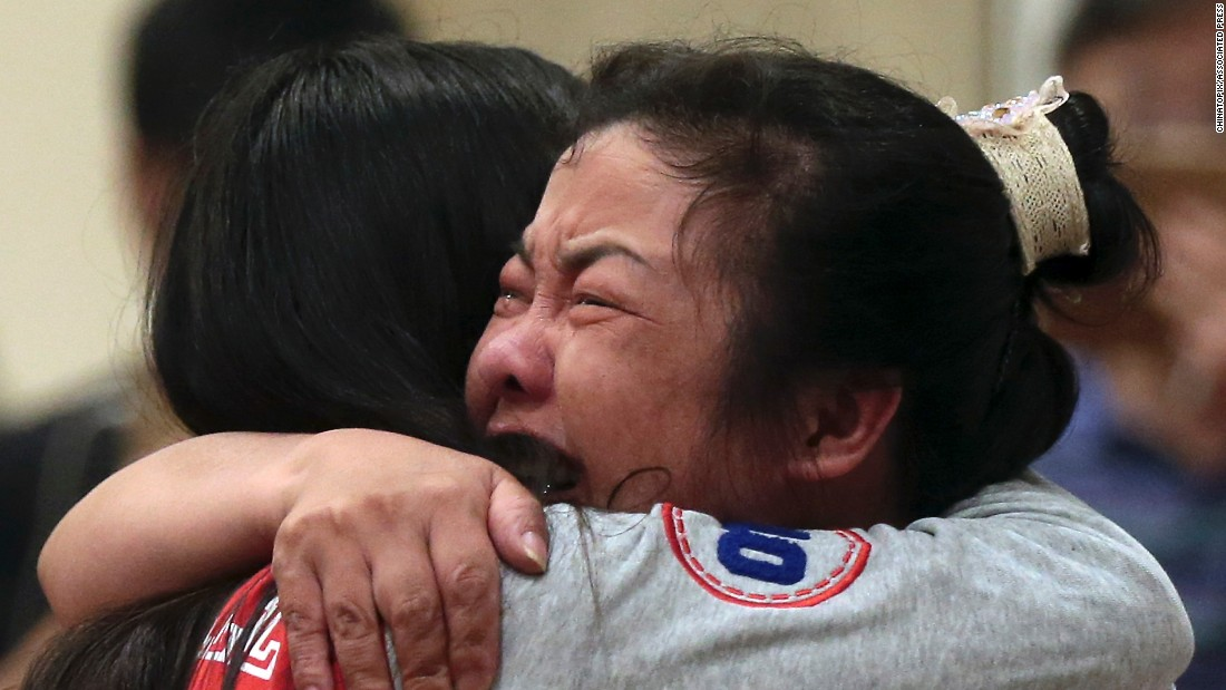 Two women comfort each other on Tuesday, June 2, at a Nanjing, China, hotel, where relatives of passengers trapped in the capsized cruise ship gathered.