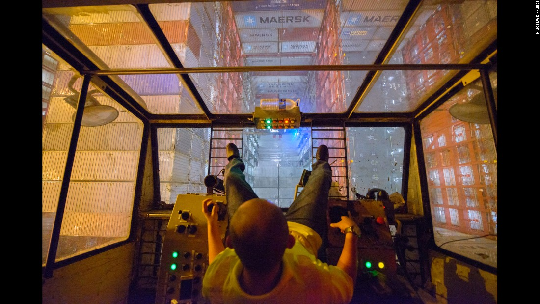 A Malaysian crane operator lowers a container into one of the Majestic's giant cargo bays.