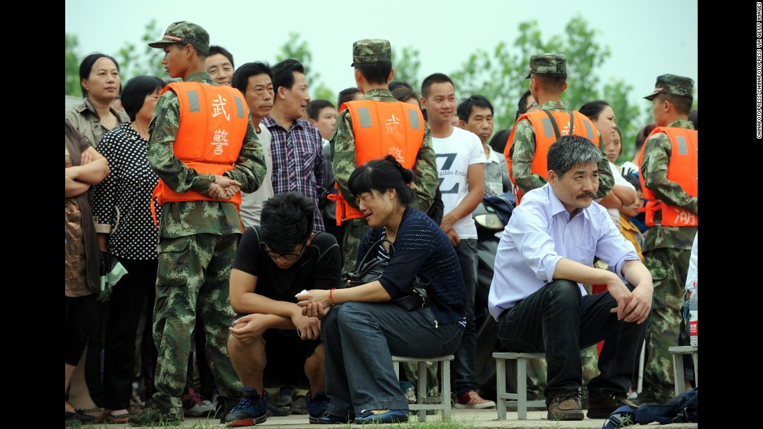 Relatives of passengers await news in Jingzhou, China, on June 3.