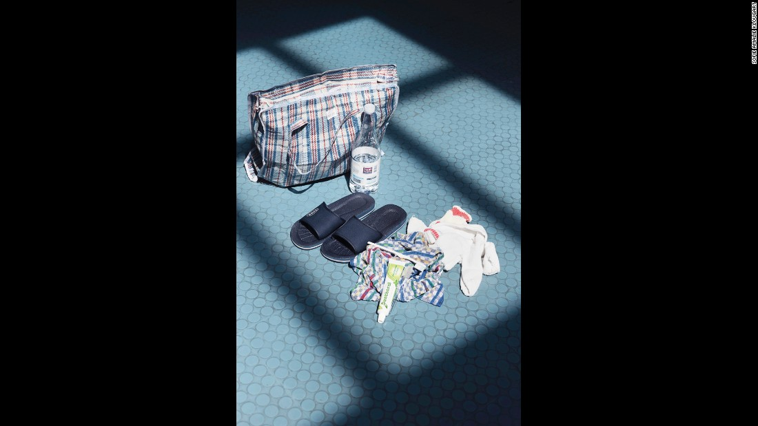 Upon arriving at the reception center in Pozzallo, migrants are provided with a welcome package that includes a tracksuit, a pair of sandals and a white plastic wristband with an identification number for the Italian immigration system.