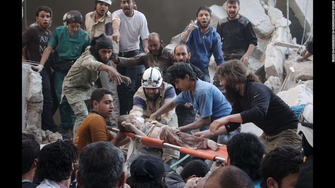 "A child is carried on a stretcher following a barrel-bomb attack in Aleppo, Syria, on Saturday, May 30. The bombs were reportedly dropped by helicopters aligned with Syria's government forces, who have been battling rebels since an uprising in March 2011 <a href=""http://www.cnn.com/2015/05/22/world/gallery/syria-civil-war-pictures/index.html"" target=""_blank"">spiraled into civil war.</a>"