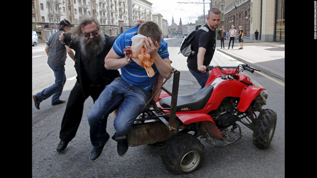 A gay rights activist is attacked by an anti-gay protester during an LGBT rally in Moscow on Saturday, May 30.