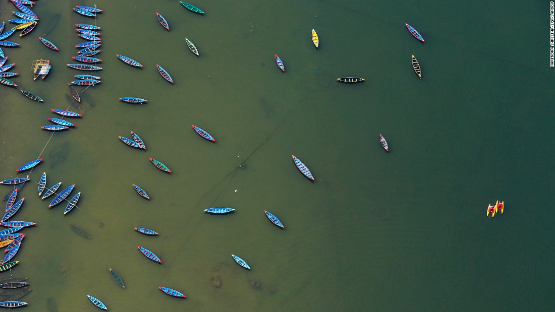 "Empty boats float on Lake Phew in Pokhara, Nepal, on Saturday, May 30. Tourism in the country has plummeted following <a href=""http://www.cnn.com/2015/04/25/world/gallery/nepal-earthquake/index.html"" target=""_blank"">a devastating earthquake</a> in April."