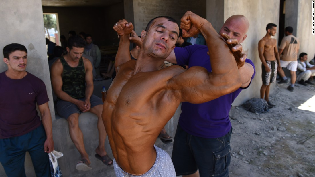 A bodybuilder in Kabul, Afghanistan, prepares to compete in the Mr. Afghanistan bodybuilding competition on Wednesday, June 3. Bodybuilding is one of the country's most popular sports.