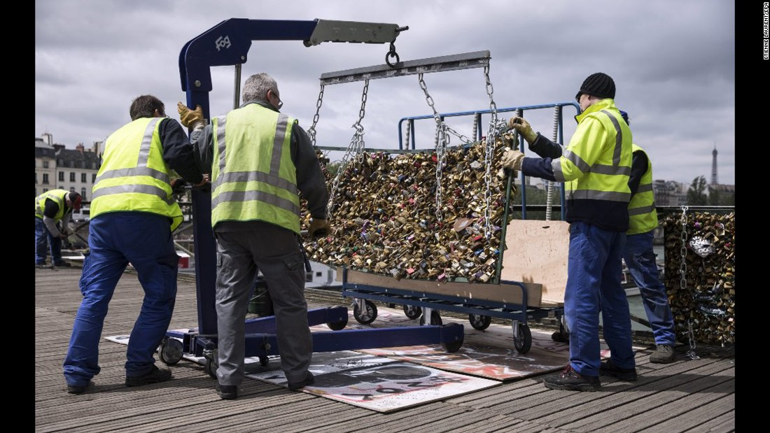 "Paris city employees remove a railing loaded with locks on the Pont des Arts bridge on Tuesday, June 2. For years, couples have put locks on the bridge to symbolize their affection -- a tradition often followed by throwing the key into the Seine River below. <a href=""http://www.cnn.com/2015/05/30/travel/gallery/paris-love-locks/index.html"" target=""_blank"">But the city decided to remove the padlocks </a>because sections of the bridge's fencing started crumbling under the locks' weight."