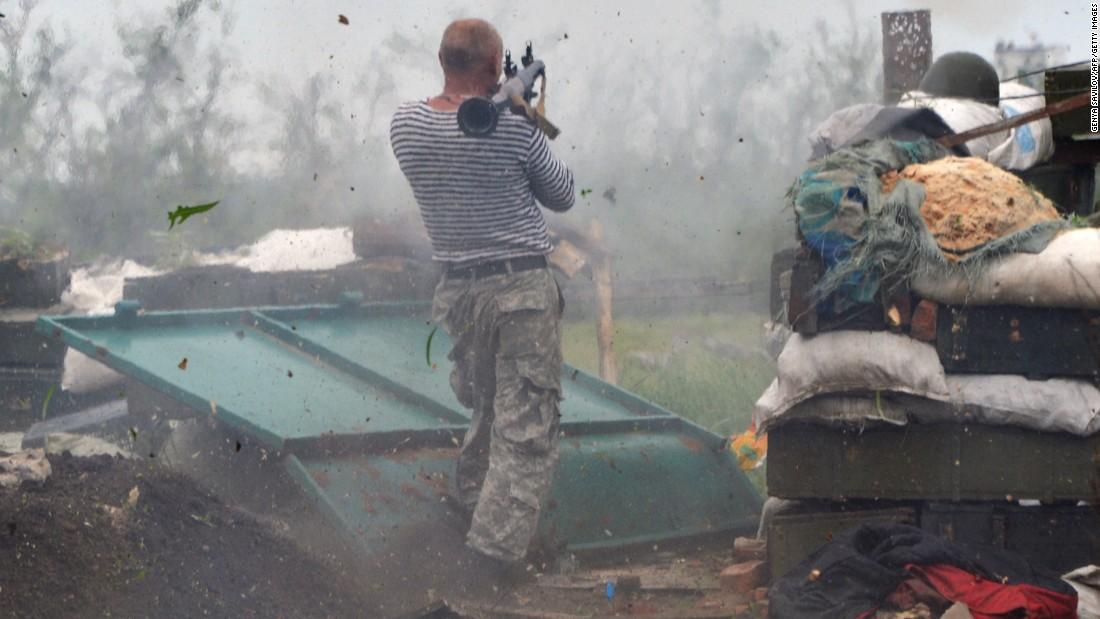 "A Ukrainian serviceman fires a weapon while fighting pro-Russian separatists near Donetsk, Ukraine, on Saturday, May 30. <a href=""http://www.cnn.com/2015/01/23/world/gallery/ukraine-crisis-2015/index.html"" target=""_blank"">Fighting continues in eastern Ukraine</a> despite a fragile ceasefire agreed upon in February. More than 6,400 people have been killed in the conflict since April 2014, the United Nations says."
