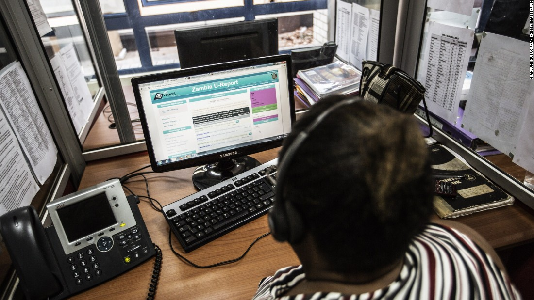"A Zambian HIV counselor looks at phone text messages coming up on the <a href=""http://www.zambiaureport.org/home/"" target=""_blank"">U-report platform for HIV and AIDS awareness</a> at a call center in Lusaka. The U-Report is a youth-centered program created by the Zambia National AIDS Council to provide confidential, free of charge, individualized and interactive counseling services on HIV and AIDS."