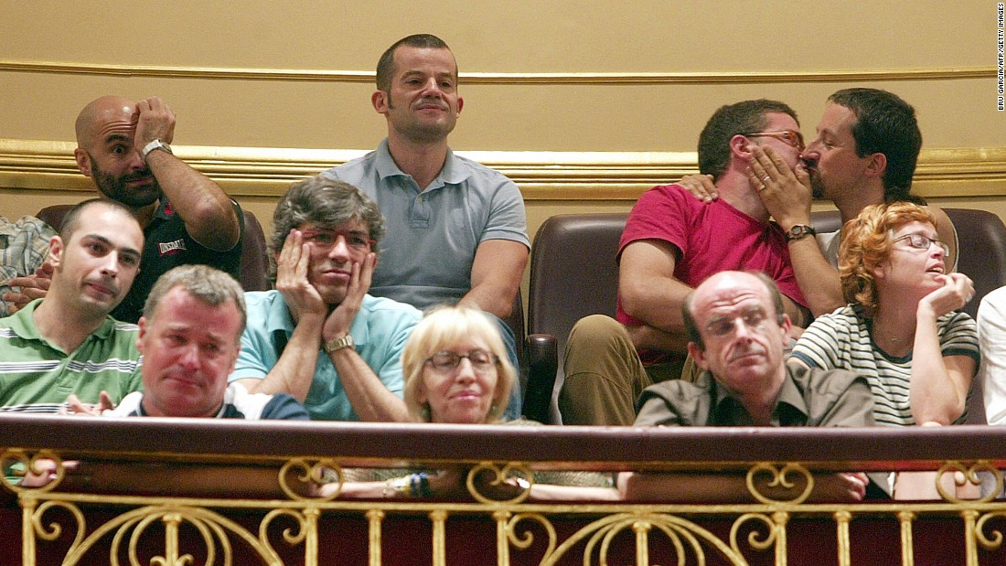 People in Madrid, Spain react to a law allowing same-sex couples to marry and adopt children in Spain in June, 2005.