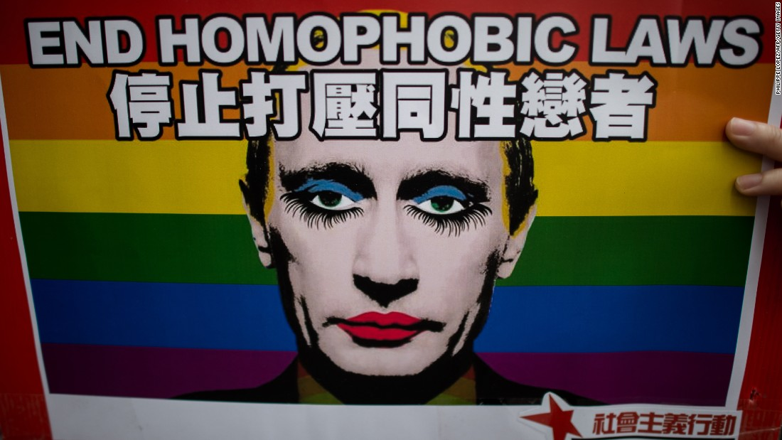An activist in Hong Kong holds a placard with a slogan over the face of Russian President Vladimir Putin during a demonstration against Russia's anti-gay legislation on the day of the opening ceremony of the Sochi Winter Olympic Games in February, 2014.