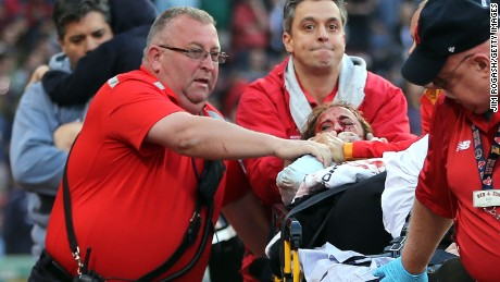 A fan is attended to by medical staff after she was hit by a broken bat during a game between the Boston Red Sox and the Oakland Athletics in the second inning at Fenway Park on June 5, 2015 in Boston, Massachusetts.