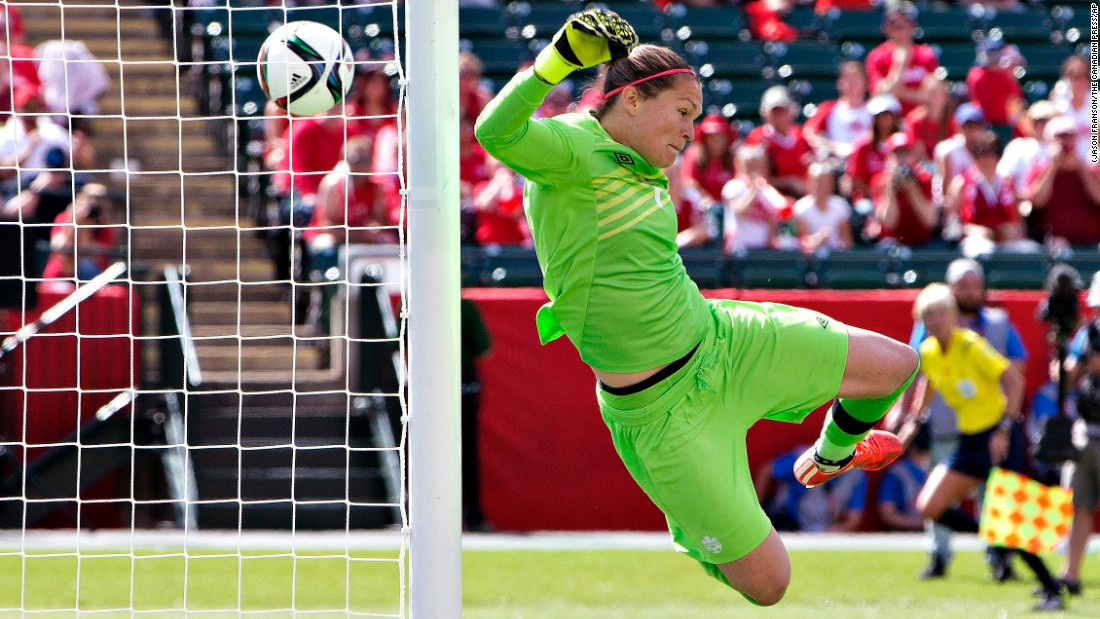 Canadian goalkeeper Erin McLeod makes a save against China in the tournament's opening match Saturday, June 6. The host nation won 1-0 in Edmonton.