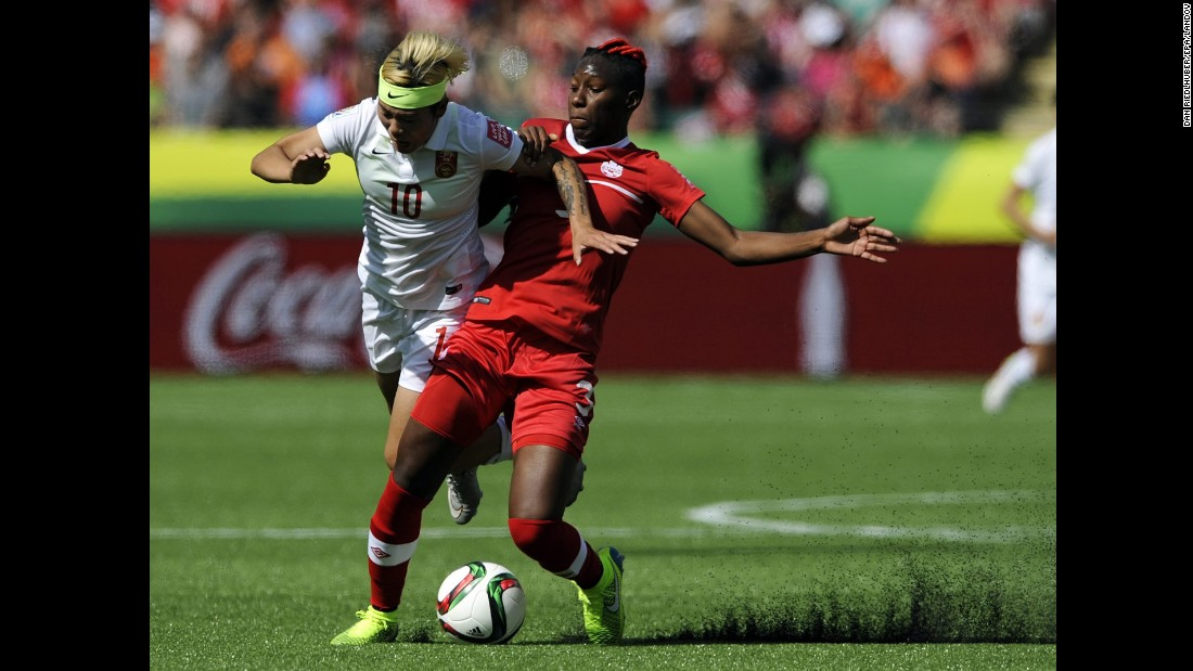 China's Ying Li, left, is tackled by Kadeisha Buchanan of Canada.