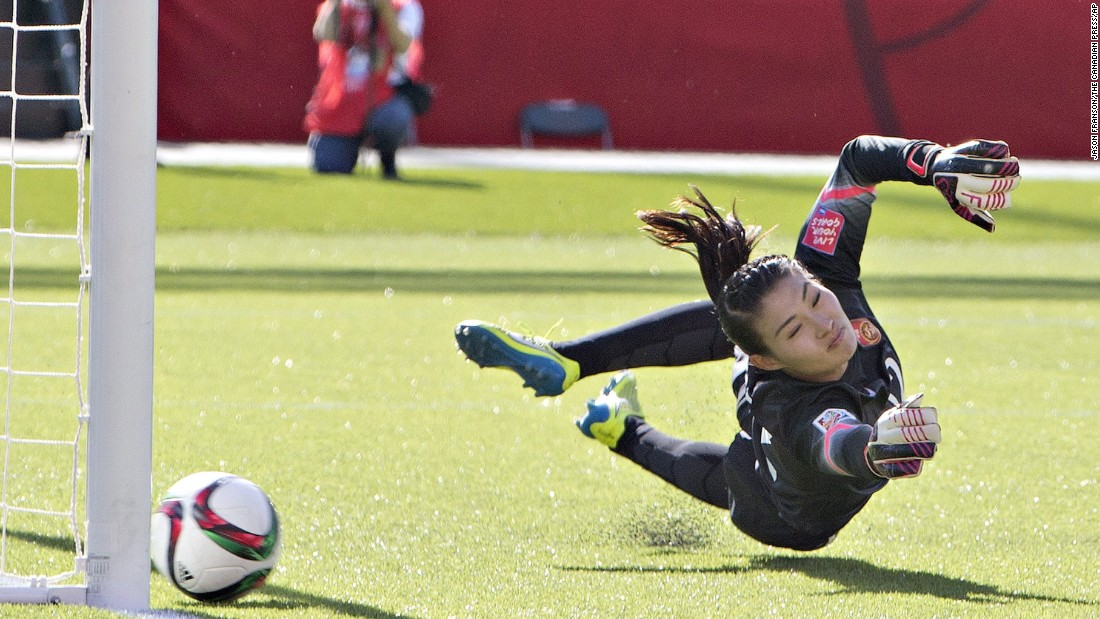 Chinese goalkeeper Wang Fei tries in vain to stop a penalty kick by Canada's Christine Sinclair. The goal came late in second-half stoppage time.