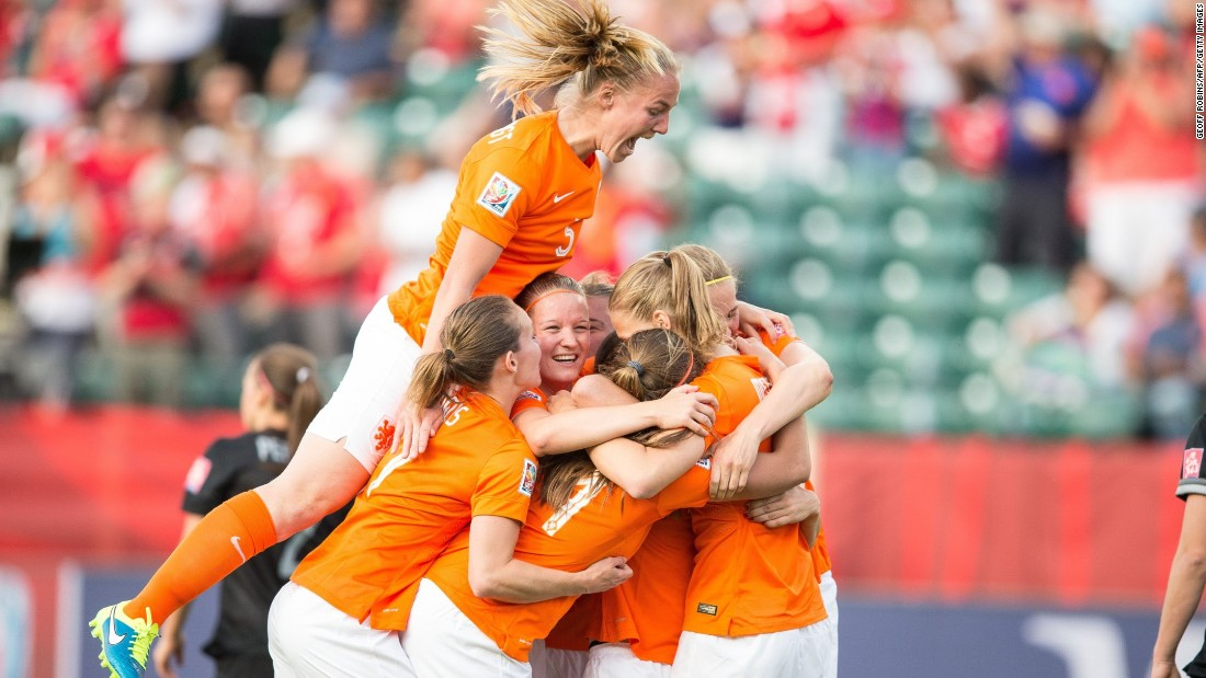 Dutch players celebrate Martens' goal in the first half.