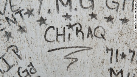 Caption:CHICAGO, IL - DECEMBER 11: Graffiti is scrawled in the play lot where 16-year-old Jeffrey Stewart collapsed after being shot on December 9, in the Humboldt Park neighborhood on the city's West Side December 11, 2012 in Chicago, Illinois. Stewart was shot about a block away and ran to the playground where he collapsed. He was shot with 17-year-old Anton Reed who survived with a gunshot wound to the hand. Reed was later arrested after vomiting three baggies of what appeared to be cocaine. Chicago has earned the nickname Chiraq because more Americans were killed in the city in 2012 than were killed in Iraq war in the same year. On December 28, 2012, after news organizations began reporting about what was believed to be the 500th murder in Chicago this year, the Chicago Police Department's News Affairs Office issued a statement stating the city's murder total remains at 499 because classification of one death investigation remains pending. They would not specify which death is pending. The total number of murders in the city has only once exceeded 500 victims since 2004. The murder rate is up about 11 percent from 2011, much of which is attributed to growing gang violence. (Photo by Scott Olson/Getty Images)
