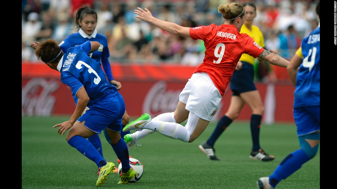 Norway's Isabell Herlovsen falls after a challenge from Thailand's Natthakarn Chinwong on Sunday, June 7. Herlovsen scored two goals as Norway defeated Thailand 4-0.