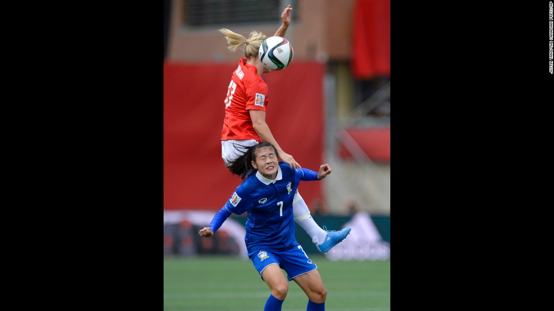 Norway's Lene Mykjaland, top, battles Thailand's Silawan Intamee for the ball.