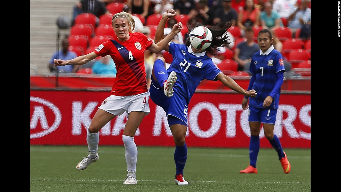 Norway's Gry Tofte Ims, left, competes against Kanjana Sung-Ngoen of Thailand.
