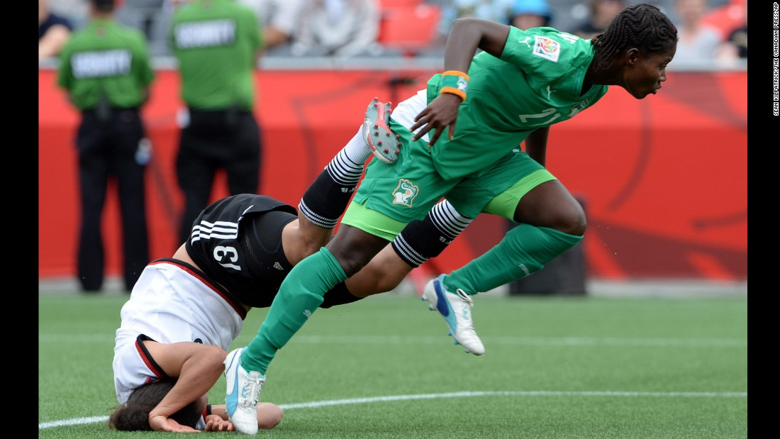 Germany's Celia Sasic falls head first into the turf after a collision with Ivory Coast's Sophie Aguie on Sunday, June 7. Germany defeated Ivory Coast 10-0 in Ottawa.