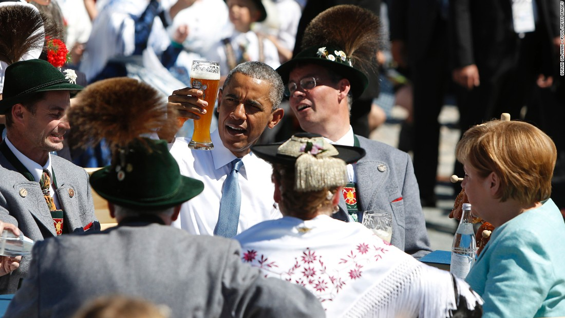 Obama enjoys a beer with Merkel, right, at the summit of G7 nations on June 7 in Kruen, Germany.
