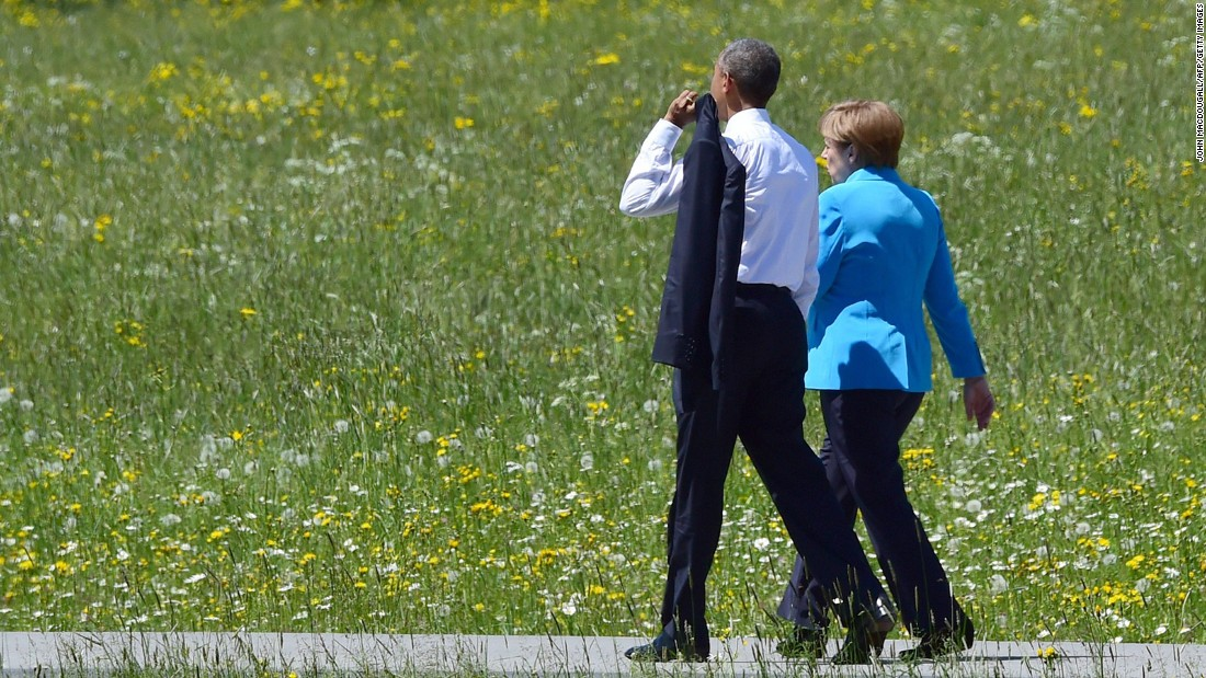 Obama and Merkel walk on their way to their first working session at Elmau Castle on June 7.