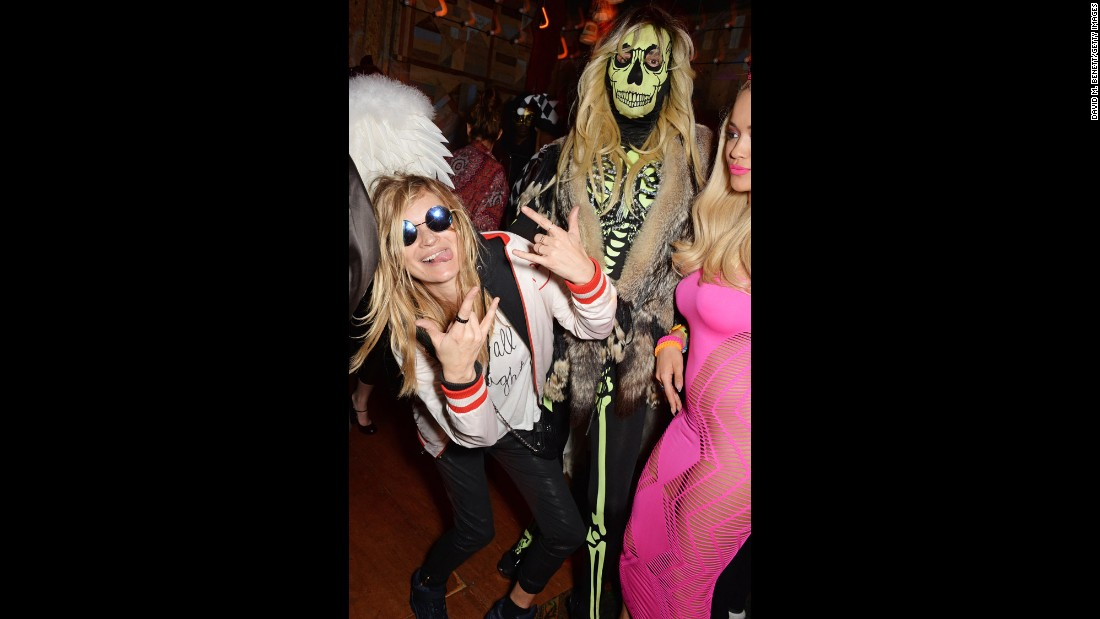Moss, left, and singer Rita Ora, right, attend a 2014 Halloween party in London.