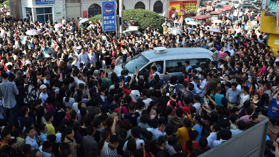Almost 9.5 million high school students in China took the 2015 gaokao in early June. Failure potentially means no degree and poorer job prospects. In this picture, parents crowd a police car outside Maotanchang High School as students leave to sit the 2015 college entrance exam.