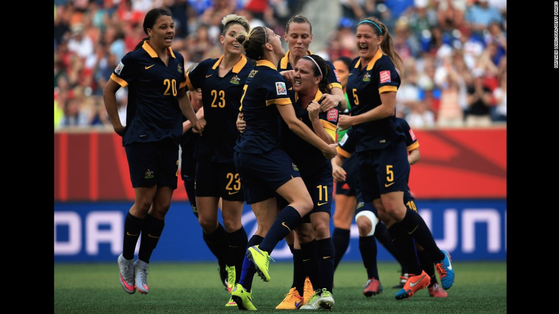 Australia's Lisa De Vanna celebrates her first-half goal with her teammates.