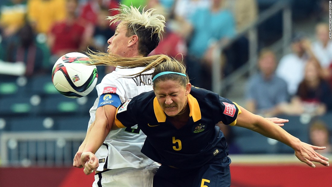 U.S. captain Abby Wambach, left, controls the ball near Australian defender Laura Alleway.