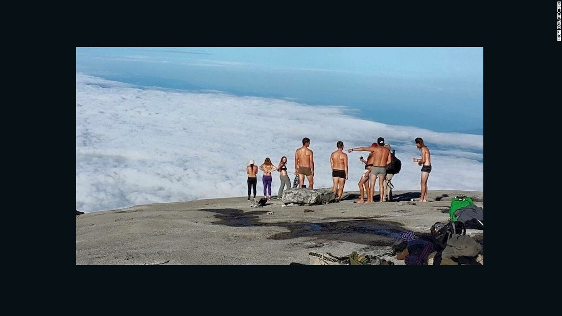 pictures showing tourists stripped naked Malaysia beach
