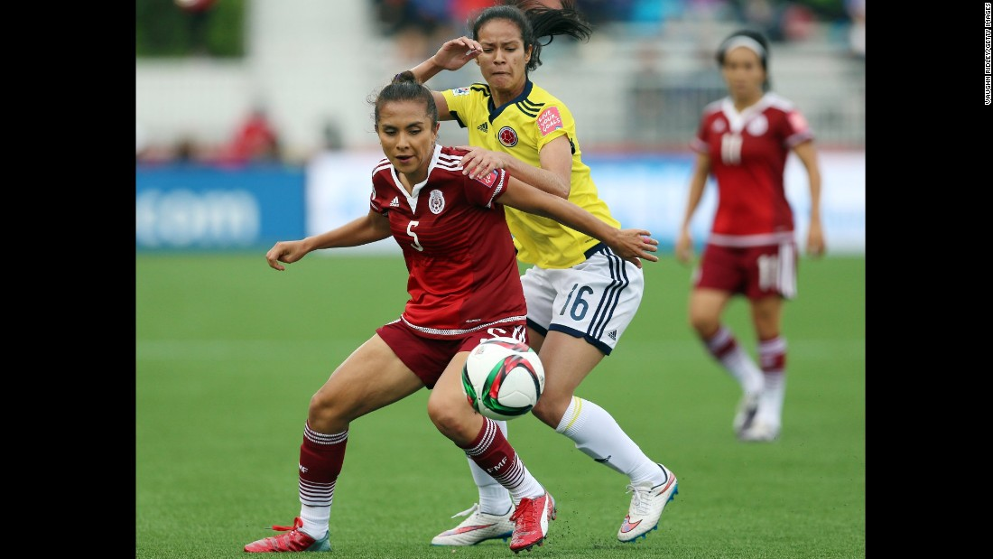 Mexico's Valerie Miranda, left, and Colombia's Lady Andrade battle for the ball during a match June 9 in Moncton. The match ended in a 1-1 draw.
