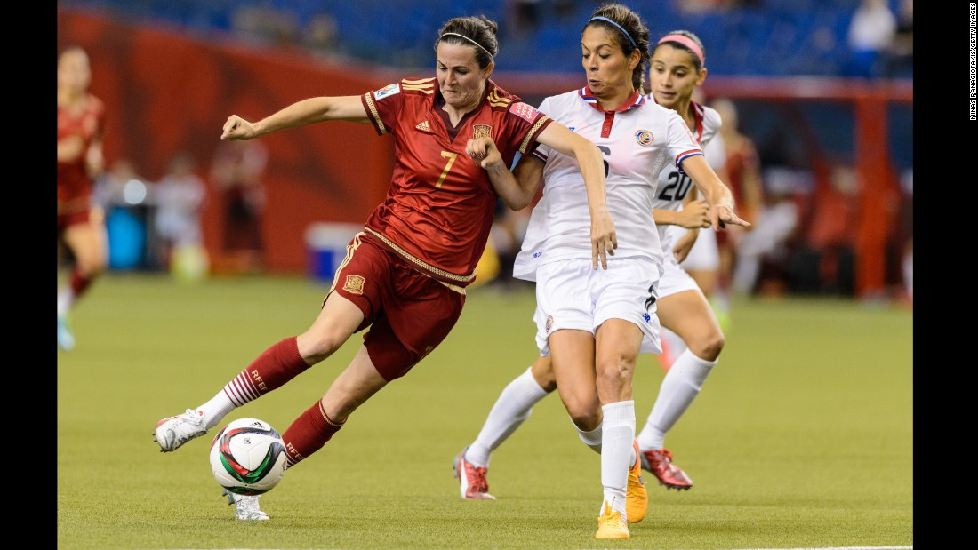 Spain's Natalia Pablos tries to dribble past Costa Rica's Carol Sanchez during a match June 9 in Montreal. The match ended 1-1.
