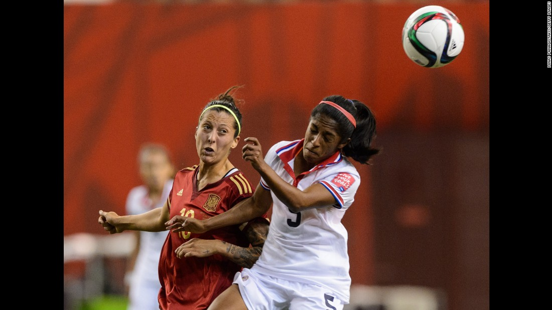 Spain's Jennifer Hermoso watches Costa Rica's Diana Saenz head the ball.