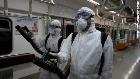 GOYANG, SOUTH KOREA - JUNE 09: Disinfection workers wearing protective gears spray anti-septic solution in an subway amid rising public concerns over the spread of MERS virus at Seoul metro railway base on June 9, 2015 in Goyang, South Korea. South Korea has reported eighth death, 2,892 quarantined, and 1800 schools closed as of June 9, 2015. (Photo by Chung Sung-Jun/Getty Images)