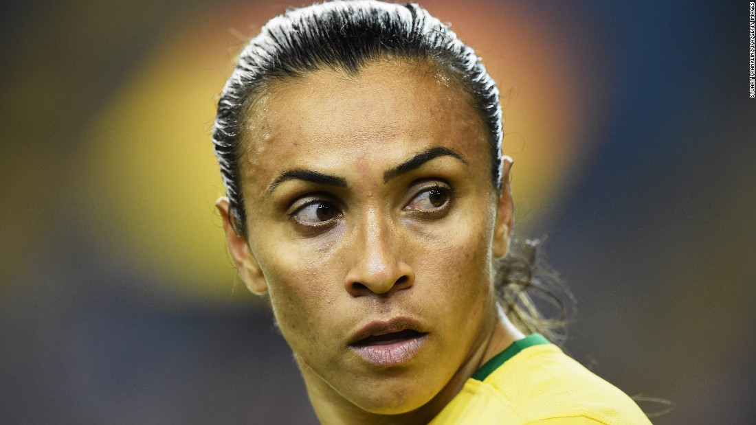Marta looks on during the game.