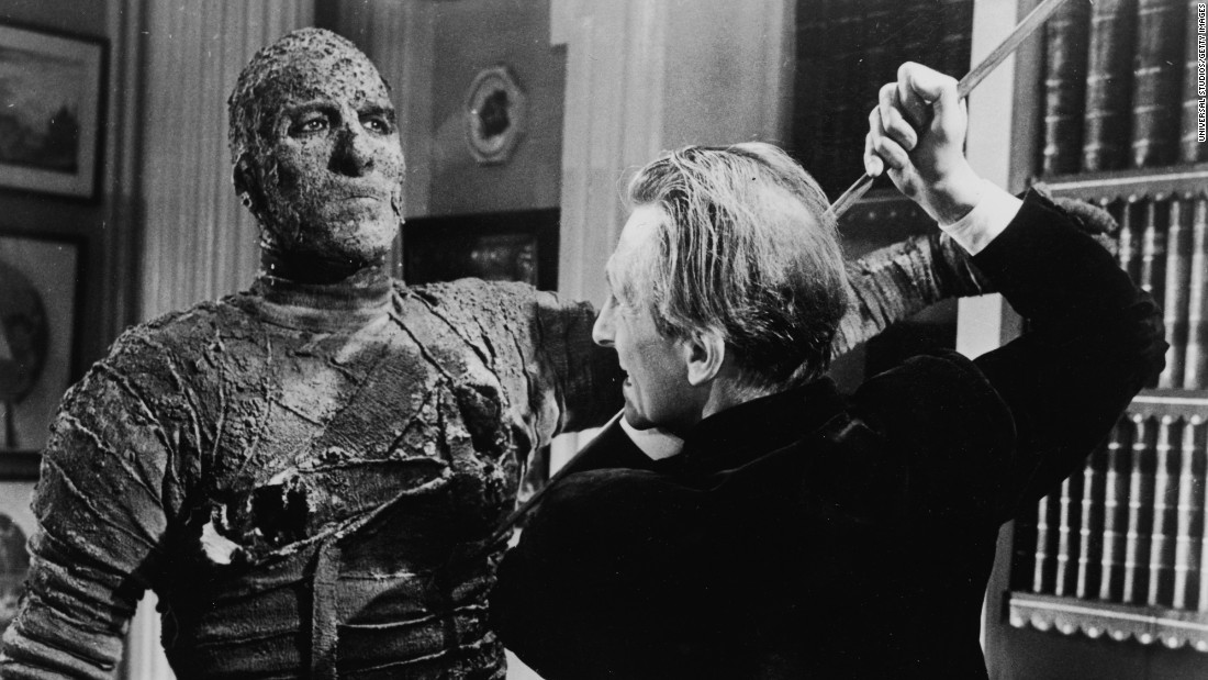 "Peter Cushing attempts to kill Lee in the 1959 film ""The Mummy."""