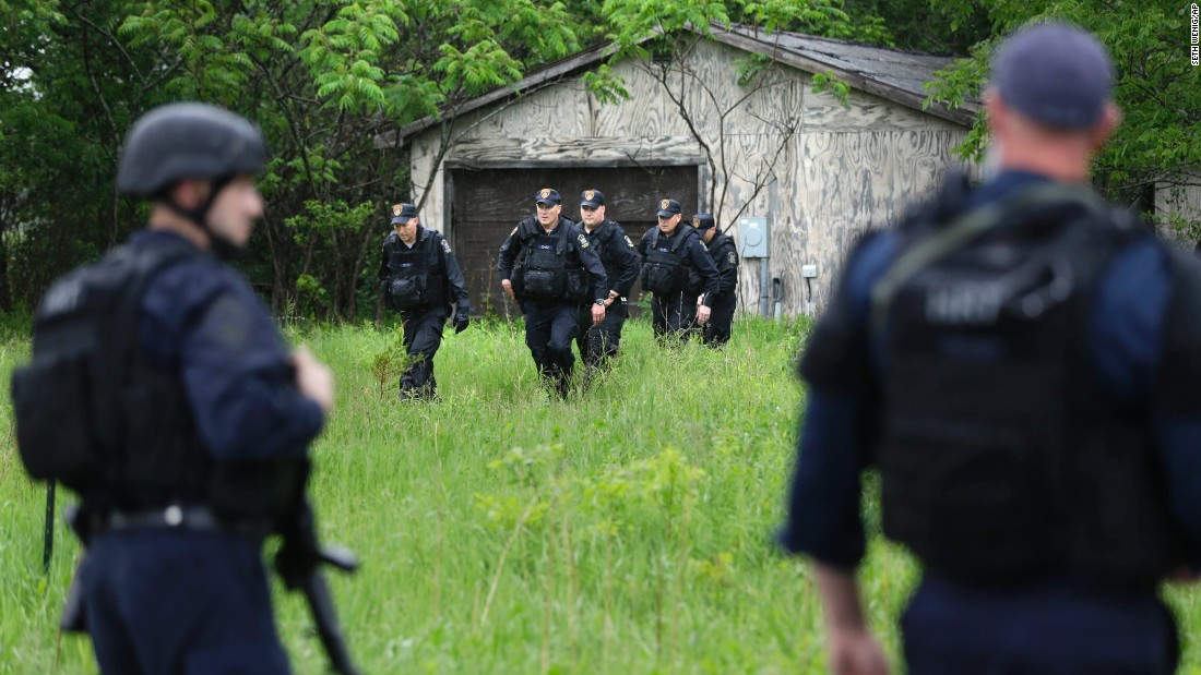 Officers continue their search in Essex, New York, on Tuesday, June 9.