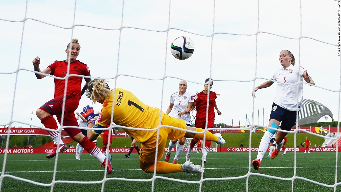 Germany's Anja Mittag, left, scores a goal past Norway goalkeeper Ingrid Hjelmseth during a match in Ottawa on June 11. The final score was 1-1.