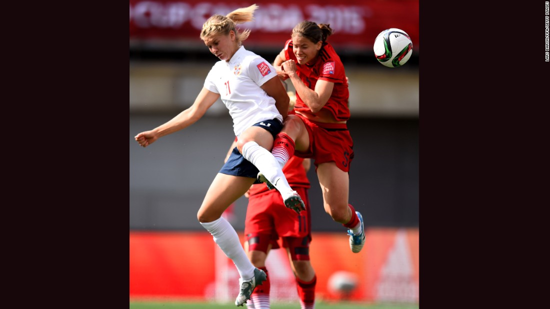 Norway's Ada Hegerberg, left, is challenged by Germany's Annike Krahn.