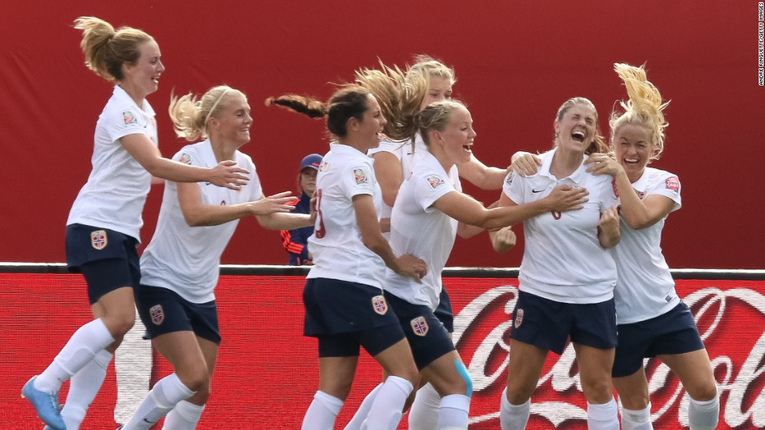 Norway's Maren Mjelde, second from right, celebrates with teammates after scoring on a free kick.