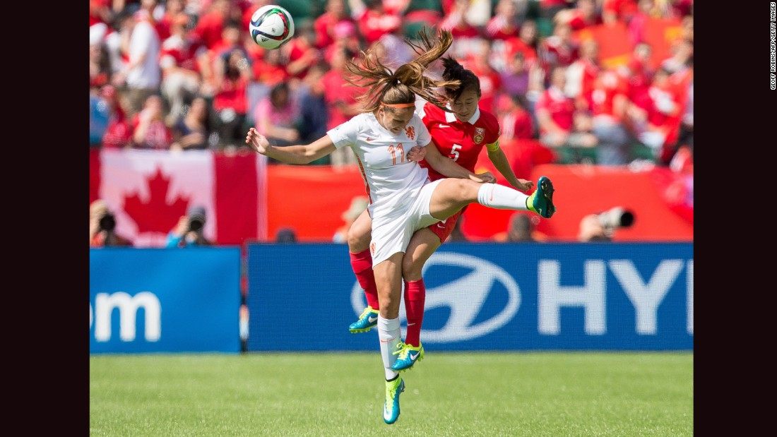Martens, left, and China's Haiyan Wu compete for a header.