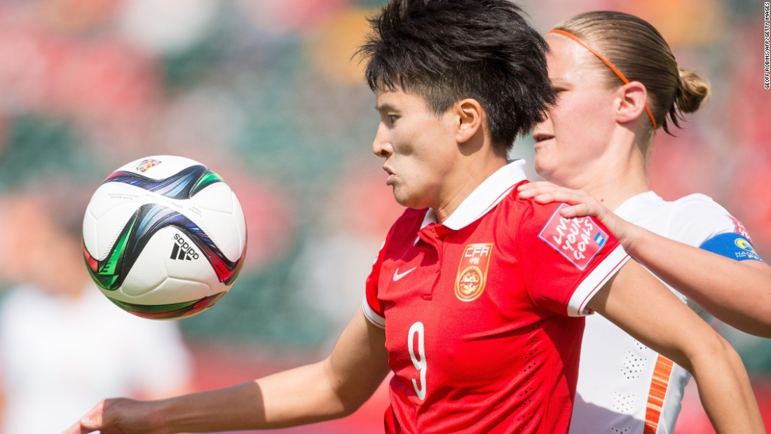 China's Shanshan Wang, left, tries to keep the ball away from Van Den Berg.
