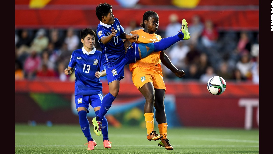 Anootsara Maijaren of Thailand, center, challenges Christine Lohoues of Ivory Coast during a Women's World Cup match in Ottawa on Thursday, June 11. Thailand won the match 3-2.