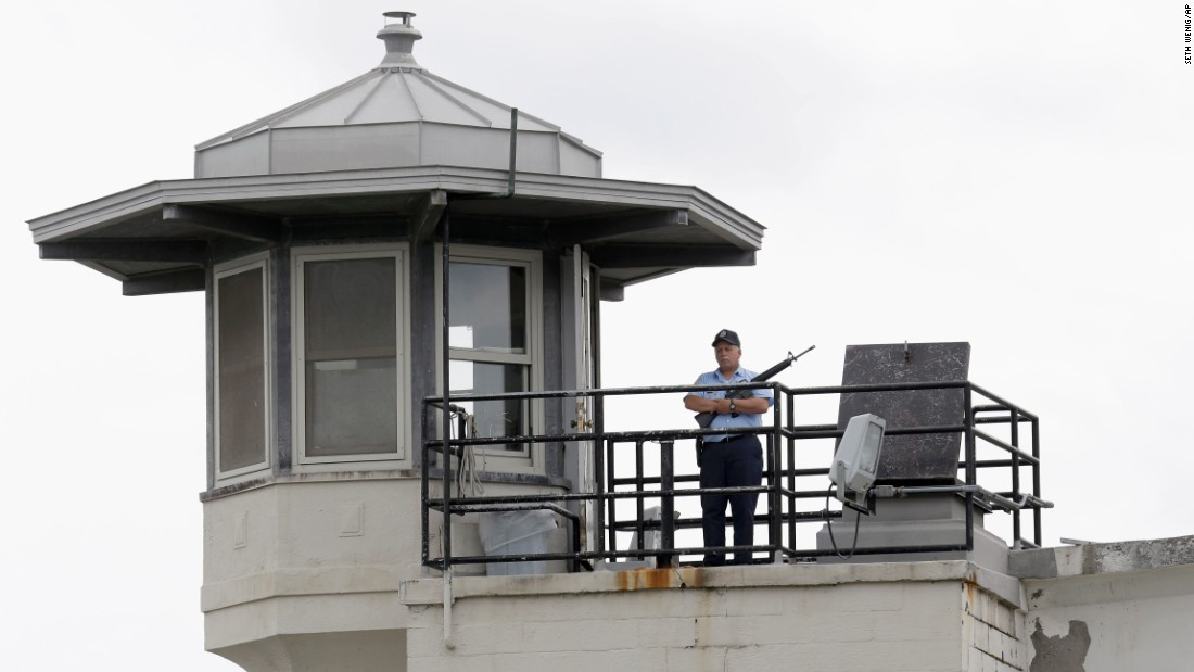 An employee stands guard at the Clinton Correctional Facility on June 10.